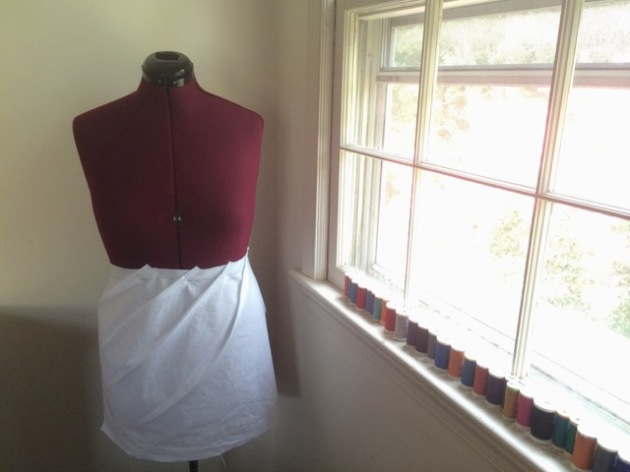 Muslin mockup of asymmetrical pleated skirt